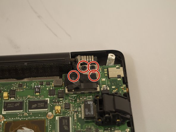 Use the Phillips #0 Screwdriver to remove the remaining four black 7mm screws on the edge of the motherboard.