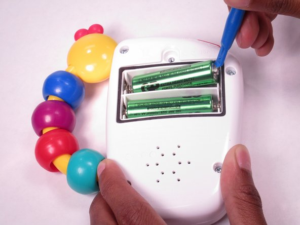 Using your fingers or a plastic opening tool, remove the batteries and  replace them.