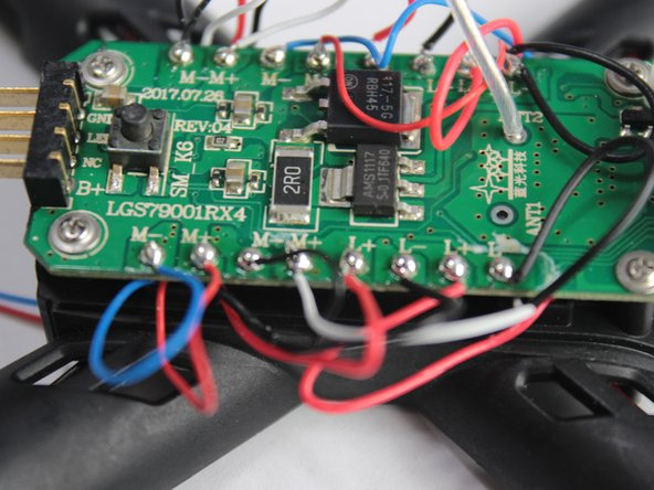The motor will either have blue and red cords, or black and white cords, with two of each kind on opposite sides of the drone. It is important that the new motor spins the same direction as the old one, and that you connect the leads to the correct port.