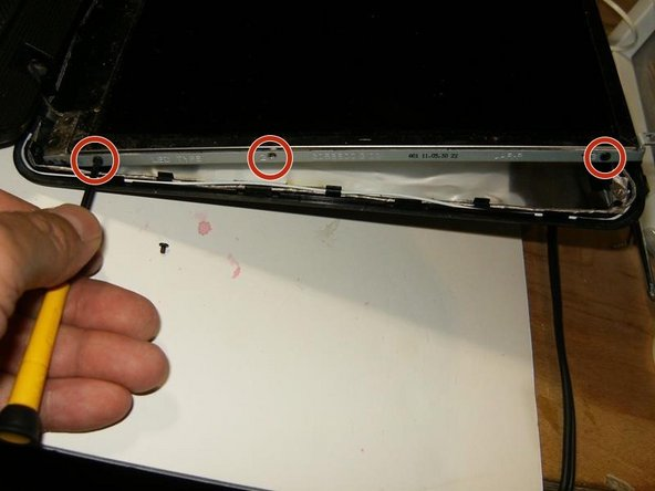There are three screws on either side that hold the panel to the frame. Remove those