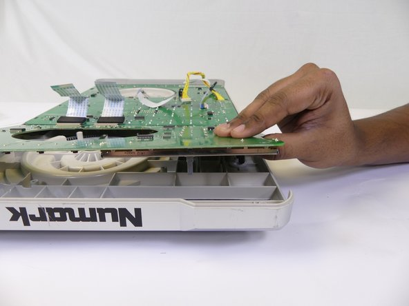 Carefully remove the circuit board from its housing.