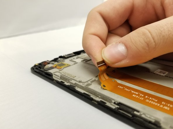 Do not damage the ribbon cable; you'll need to save it for reassembly.