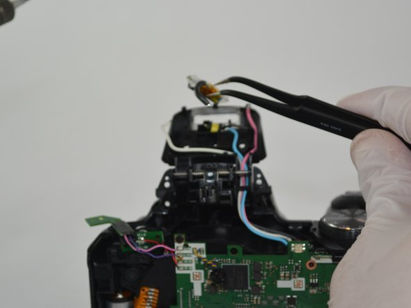 Using the tweezers remove the flashbulb.