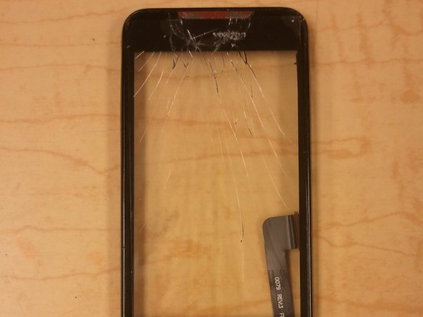 Once the LCD has been removed from the frame, the Digitizer can be gently pushed out from the back.