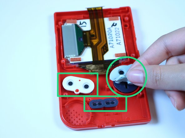 Image 1/3: Use a plastic opening tool to remove the buttons.