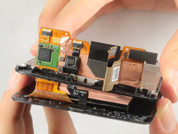 Carefully fold the digitizer such that it ends up in the middle of the wiring plate.