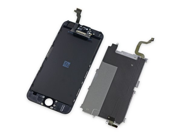 This metal plate and the front panel assembly it covers are perfect examples. The design mirrors that of the iPhone 6 Plus, which in this case is a definite improvement.