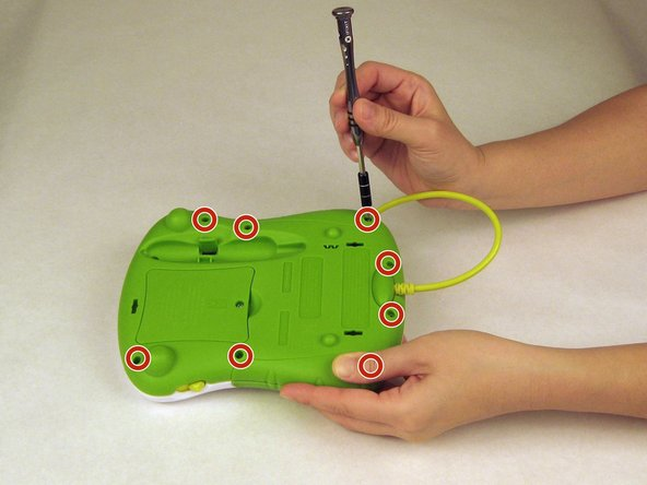 Use a Phillips screwdriver to remove the nine case screws from the back of the toy.