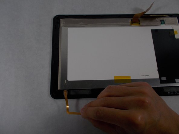 Peel back the ribbon cable resting on the screen.