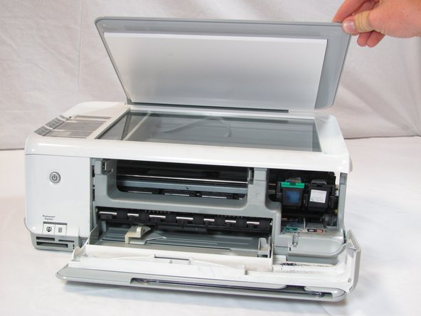 Image 1/2: Lift the scanner lid to expose the scanner glass.