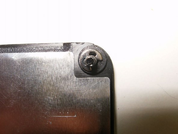 The screw that holds the cover on, has a spring clip that keeps the screw attached to the cover. during removal of the screw, this clip might come off.