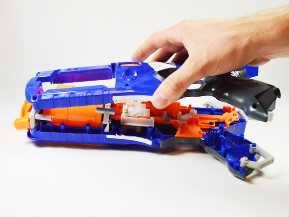 At this time, remove the blaster cover to reveal its internals.