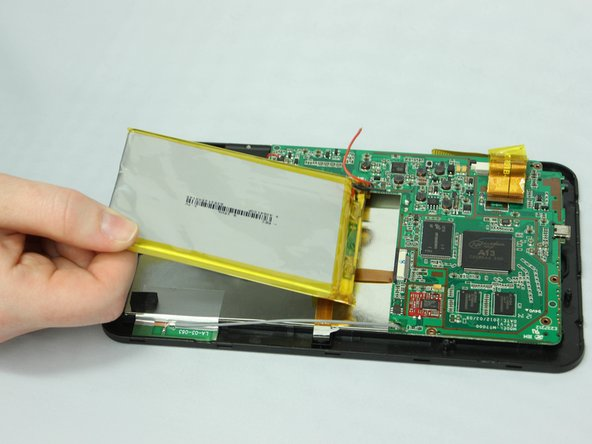 Image 3/3: Lift the battery out of the device using your hands.