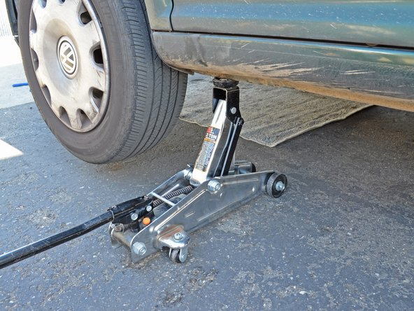 Place your jack back in the same location on the frame you used to jack up the car. Raise the jack until it touches the jacking point on the frame.