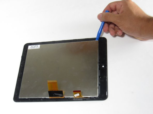 Image 1/2: Make sure the display ribbons are not tucked underneath the LCD display when reassembling the screen and LCD display (as shown in the first image of this step).