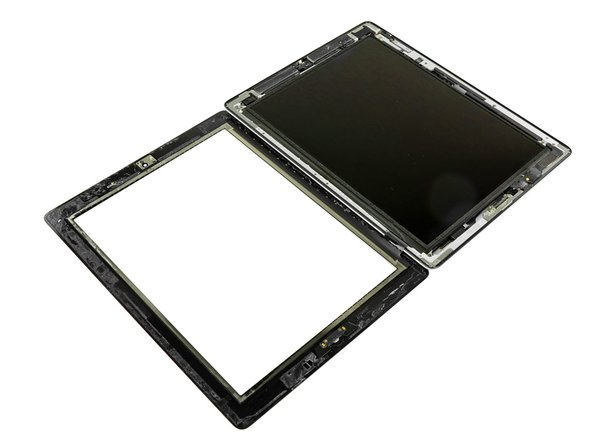 Lay the front panel next to the rest of the iPad 2.