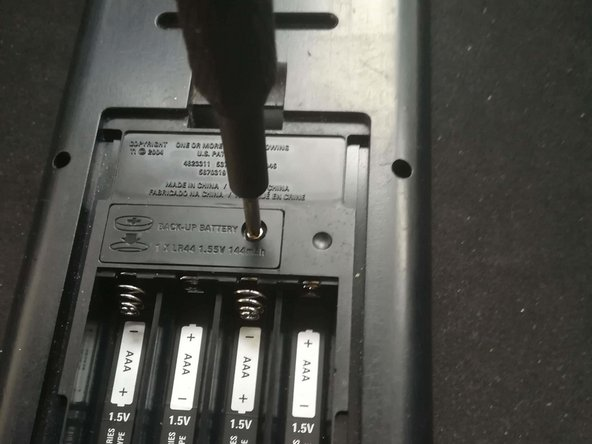 use philips #0  to remove the plate from the back up battery.