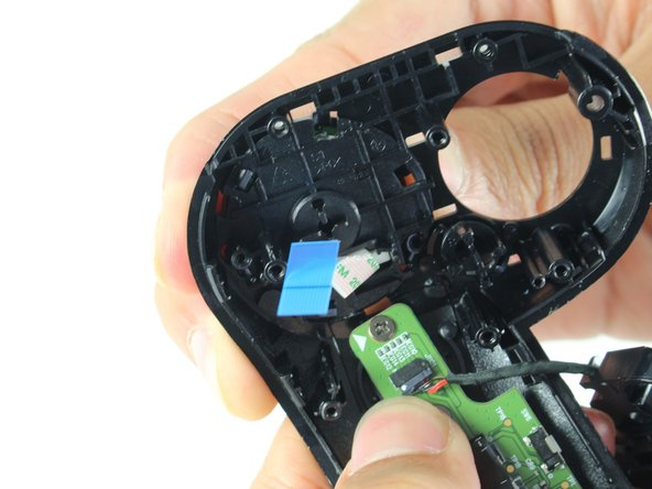 Place your thumb on the outer edge of the touchpad on the other side of the controller.