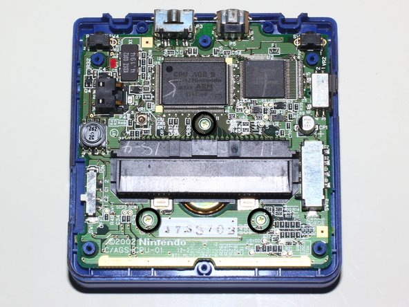 Remove screws and lift back cover off giving access to motherboard.