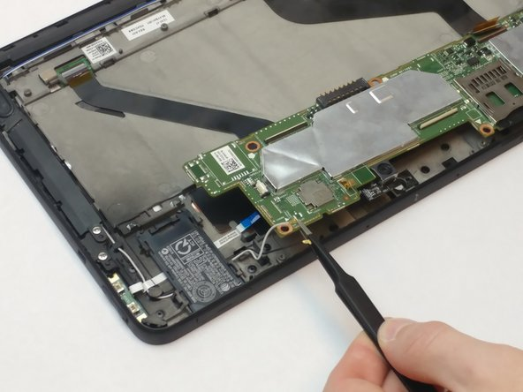 Rotate the motherboard upwards from the tablet using tweezers, but do not remove completely from the device. As you lift, disconnect the black and red wire located underneath the motherboard before removing it completely from the tablet.