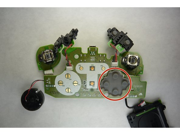Return to the board that was removed from inside of the controller.  Reorient the board so that it is positioned in the same manner relative to you.  Remove the rubber cover over the ABXY sensors.