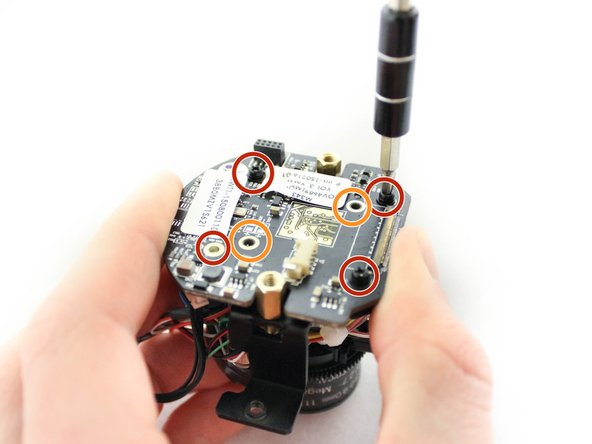 Do not use a magnetic screwdriver or drill bits on the camera's motherboard. This can damage the camera's motherboard.