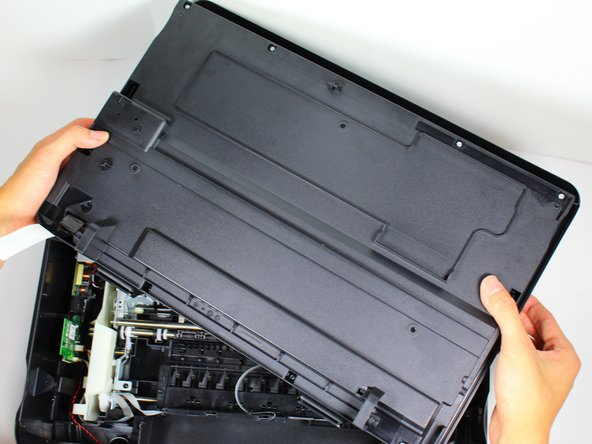 Flip the cartridge access door with two hands so that the non-glass side of the cartridge access door is on top.