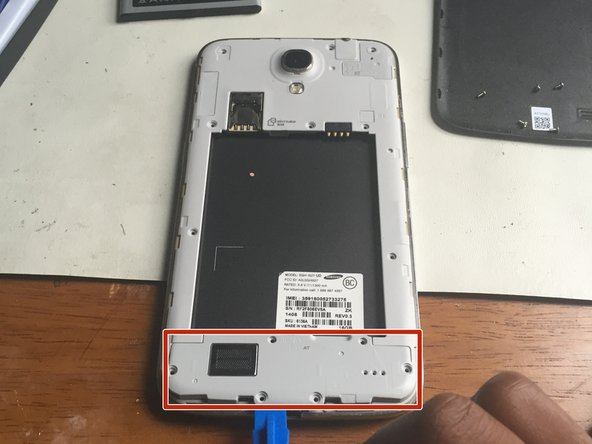 Using an opening tool, gently pry the speaker upwards and remove it.