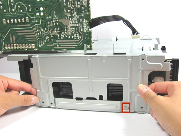 Rotate the device so that the side with the circuit board is facing towards you.