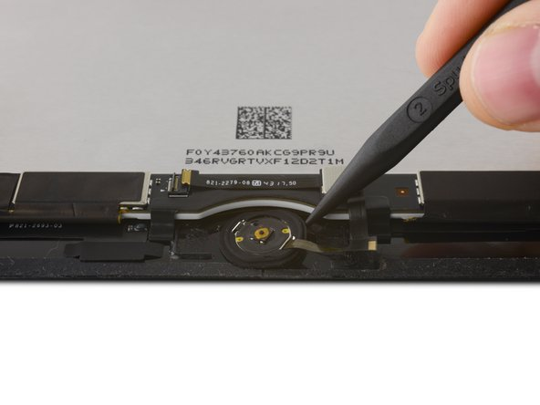 Image 3/3: Use the pointed end of a spudger to gently pry the Home Button assembly up from the display.