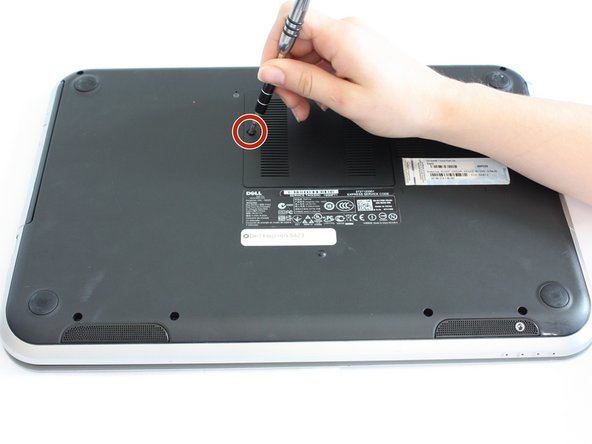 Use a J0 bit tipped screwdriver  to unscrew the one 6 mm Phillips screw on the RAM cover.