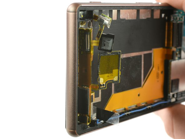 To fully remove the display off your phone, you need to thread the display flex cable through the gap of the mid frame in the bottom end of your phone.