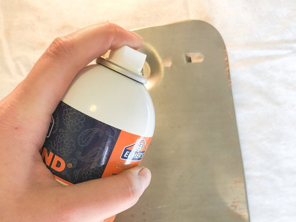 Use the spray adhesive to spray the metal plates and apply the foam  to their respective pieces.