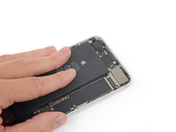 Be sure to hold onto the battery as you remove the final strip, or it may fling out of the iPhone unexpectedly.