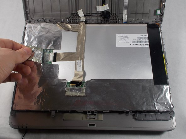 Fold the protective foil back from the ribbon cables.