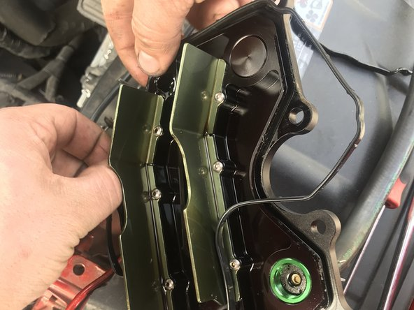 Install the new PCV plate gasket.