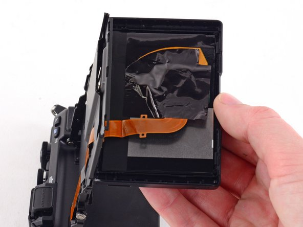 Image 3/3: Do not attempt to fully remove the screen, as it is attached to the assembly by a ribbon cable.