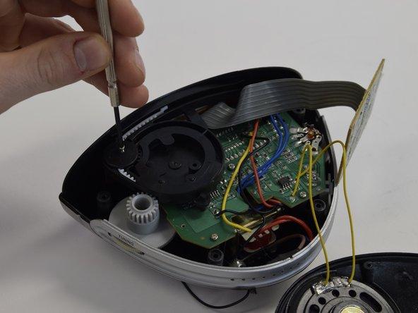 Unscrew 2 screws of the  radio tuning system.