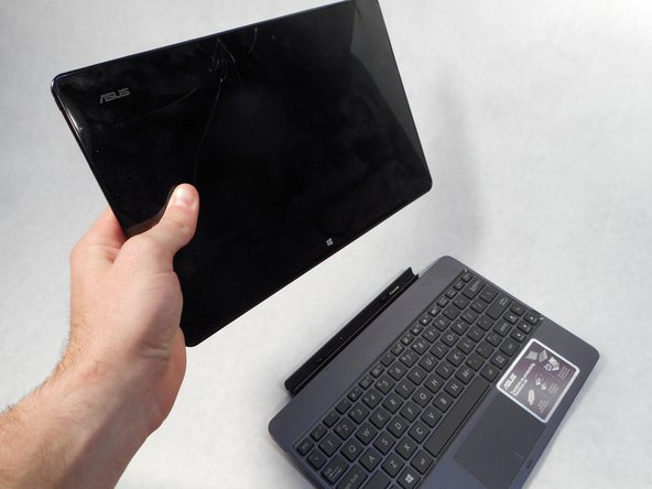 To remove the keyboard, simply depress the switch on the left side of the screen and pull the tablet portion off.