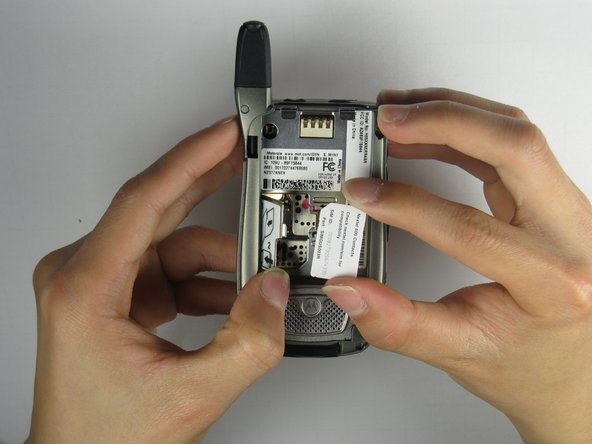 Lift the SIM Card with your thumb and forefinger to complete the removal of the SIM card!