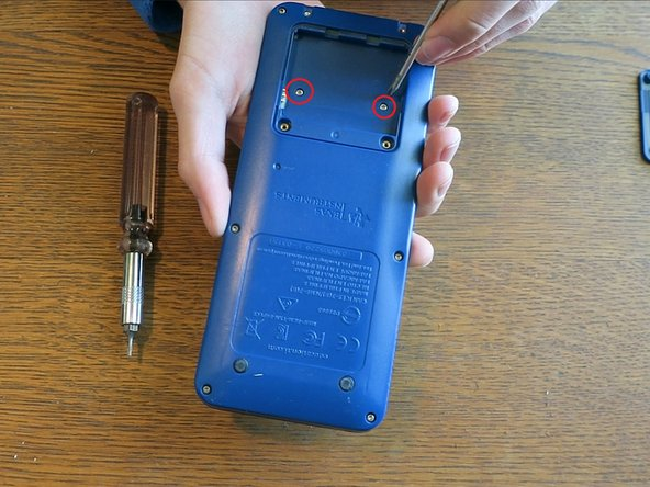 Use the Phillips #00 screwdriver to remove the screws underneath the battery