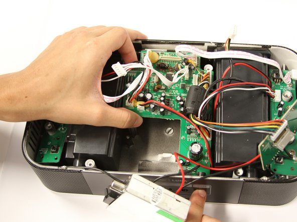 Gently remove the motherboard from the casing. Be careful with the display housing.