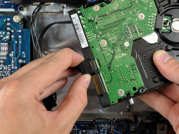 Pull the SATA data cable away from the hard drive.