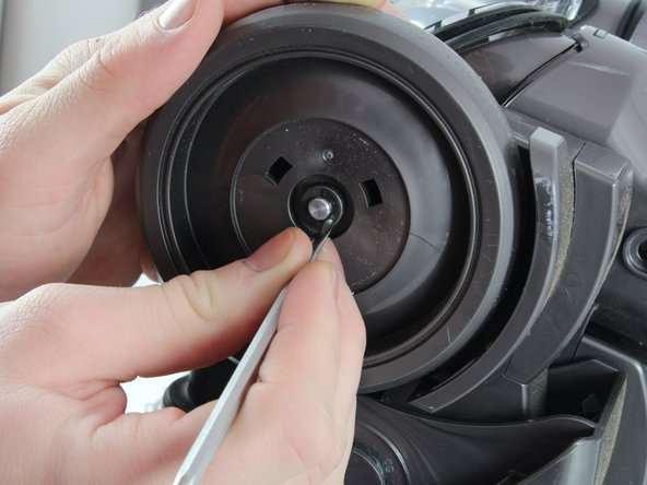 The e-clip is very small and may be hard to identify.  It is a small metal ring between the metal axle and the plastic wheel.