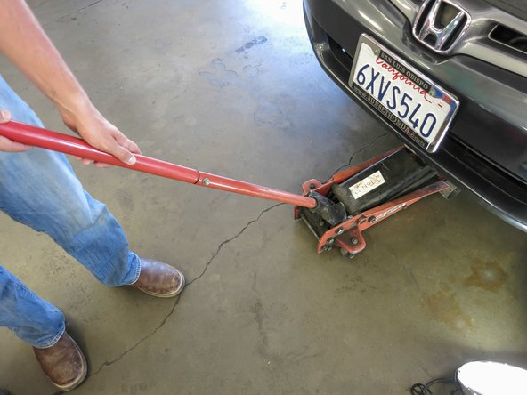 Clear the area underneath the car of people or debris. Make sure the jack stands are properly supporting the car.