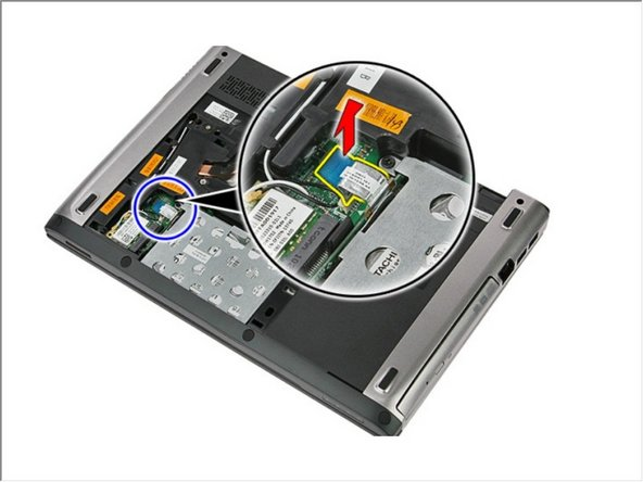 Open the clip that secures the hard-drive assembly to the computer.