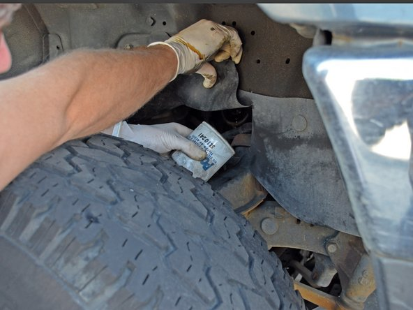 If the filter is too tight to turn by hand, use an oil filter wrench. A wrench that fits over the top of the oil filter is ideal as there is very little space on the sides of the oil filter.