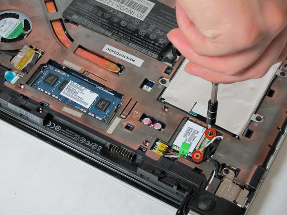 Remove the screws from the WLAN card