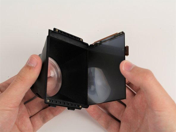 Remove the screen from the eyepiece housing by pulling the two pieces away from each other.