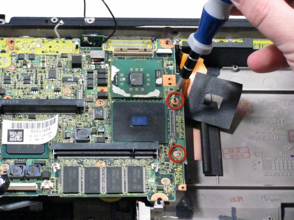 Image 1/2: Remove the remaining screws indicated in blue